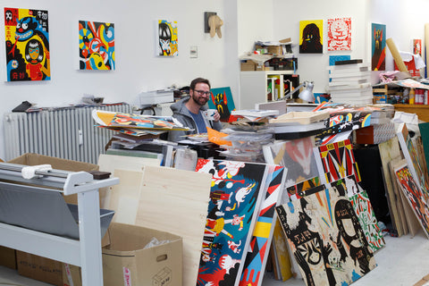 Roman Klonek at work in his art studio surrounded by paintings