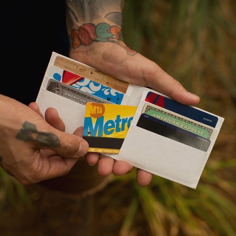 image of man holding an open wallet - artist wallets