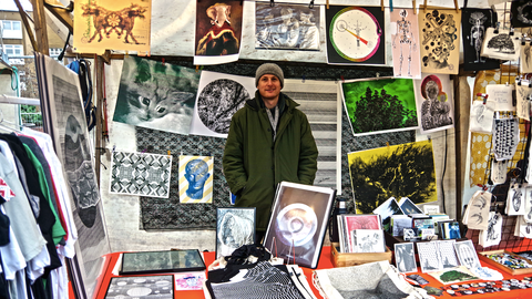 popular artist profile - image of dylan bakker at his art stand
