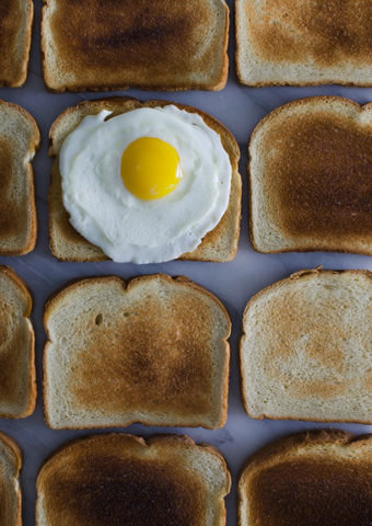 image of toast and an egg - slim wallet