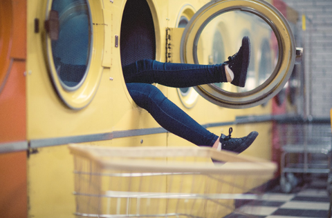 image of legs sticking out of a washing machine - slim wallet