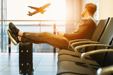 image of man sitting at an airport - thin wallets