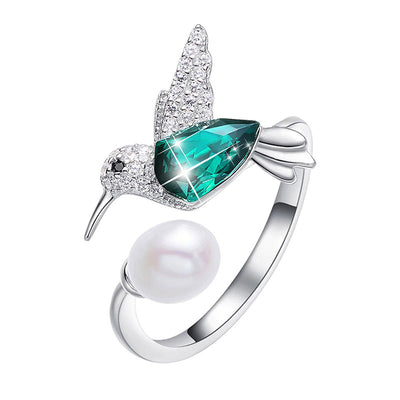 beautiful silver swarovski bird ring adjustable with pearl green emerald