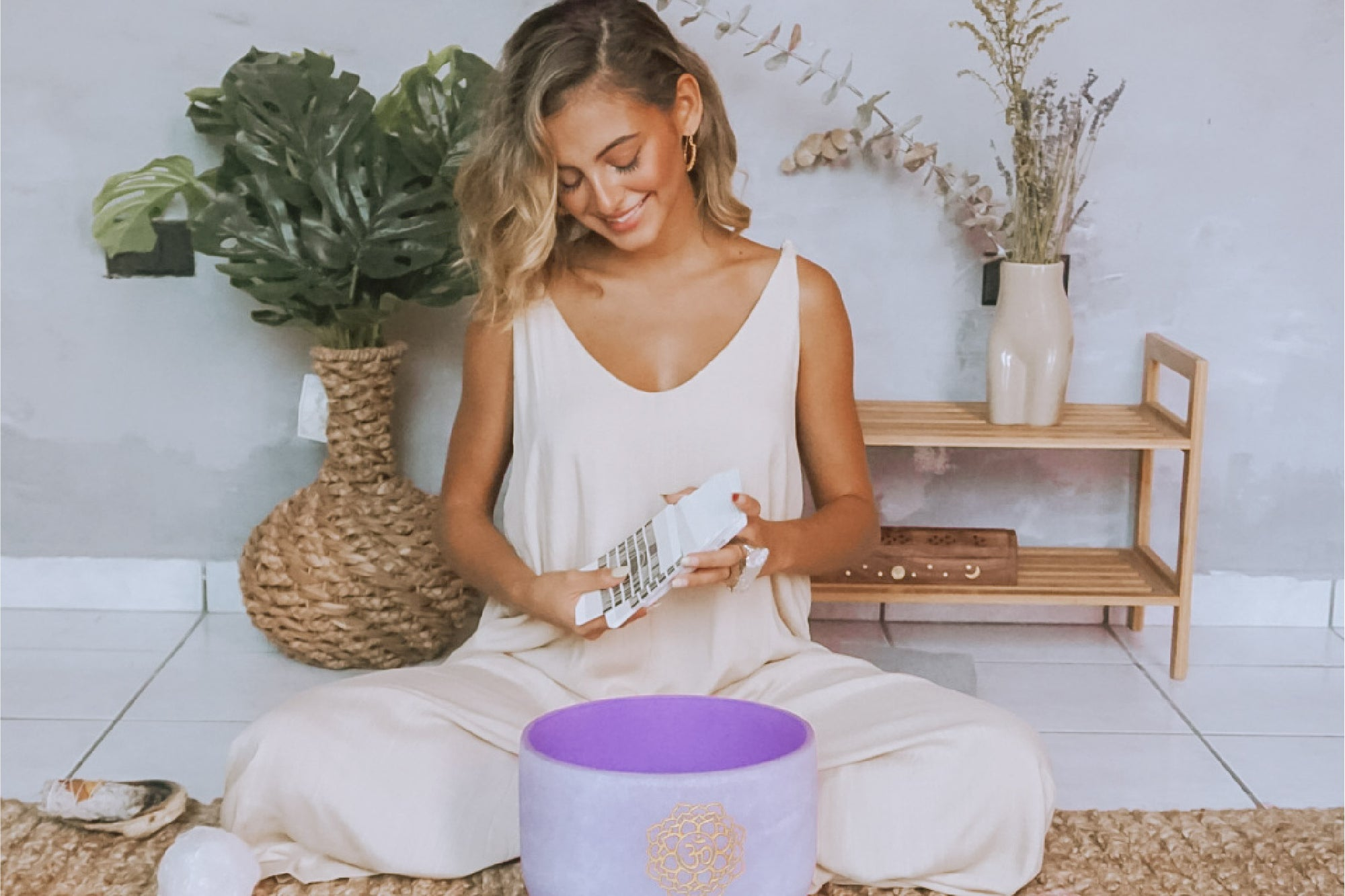 Picture of Amanda Antonella meditating with crystals and a singing bowl