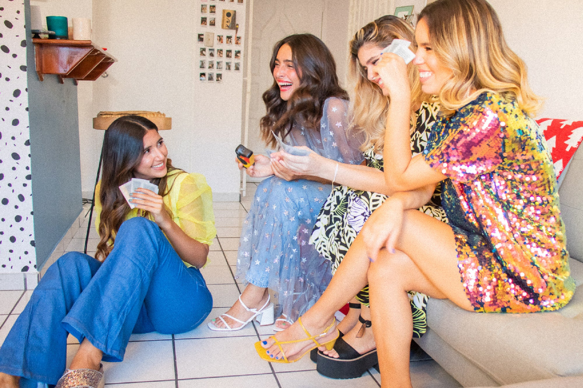 Picture of group of girl friends (The girls of Amapolia) playing cards and laughing.