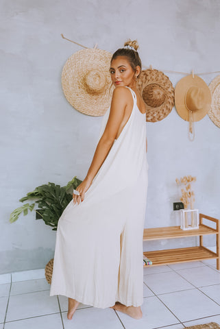 Amanda Antonella looking over her shoulder in the Strappy Oversize Overall Jumpsuit