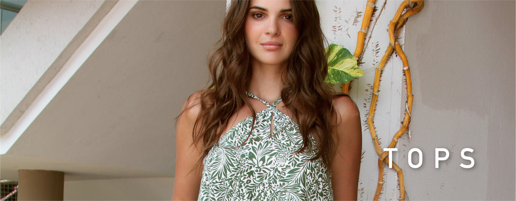 Tops. Photo of model wearing the Pereyo top in the green flower print.