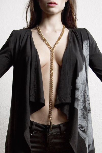 NORDENFELDT Bullet Necklace long metal necklace with bullet charm in golden, worn by Tarja Turunen