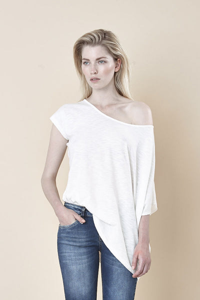 NORDENFELDT Nude Lenja, asymmetric top in crème with broached sleeves and wide neckline, made from cotton with flambé structure