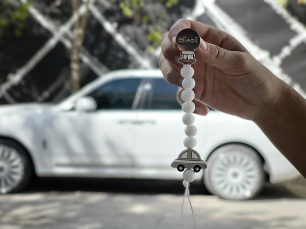 ALi+Oli Car Pacifier clip with a rolls royce white car