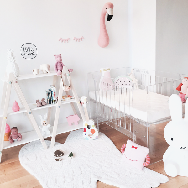 Pink wooden sleep eyes in modern nursery