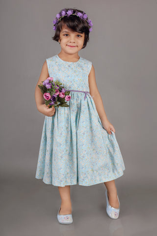 Light Blue Dress with Purple Ribbon