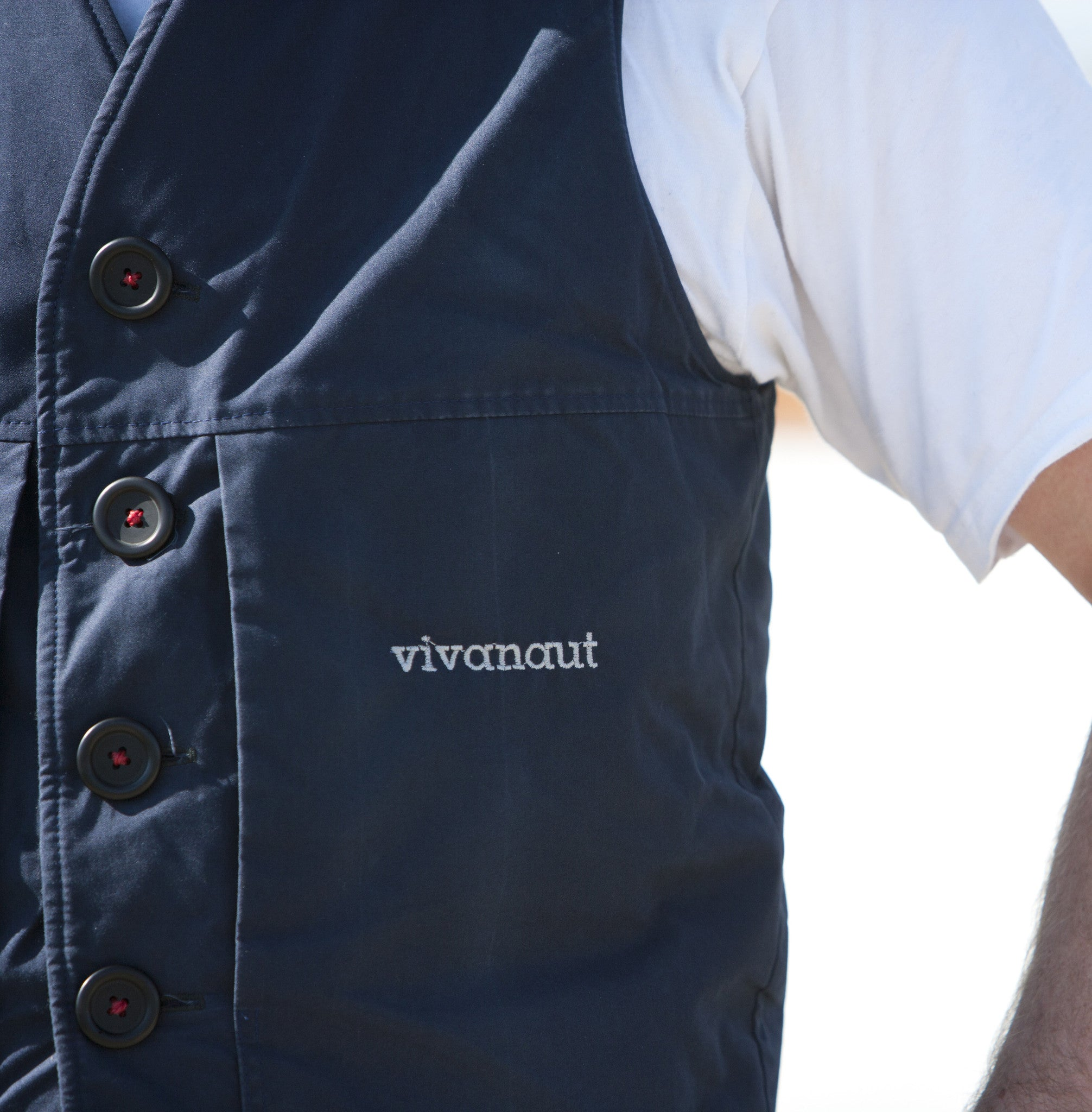 Welsh rarebit vest in blue with button and logo detail