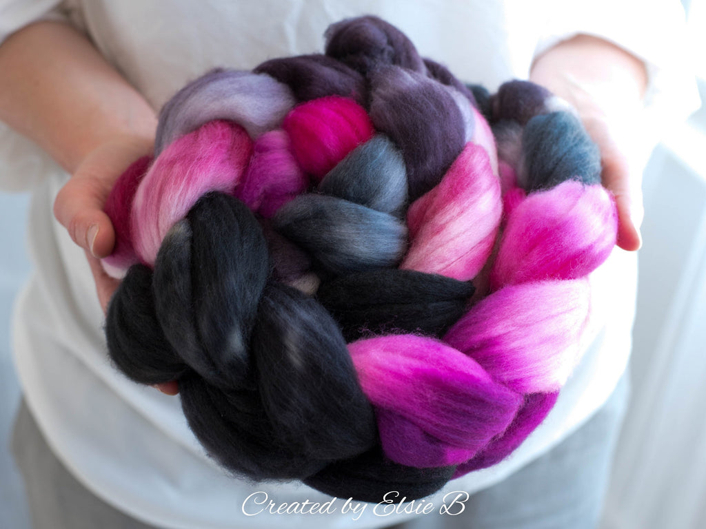 Superwash Merino/ Nylon 'Derby Girl' 4 oz black combed top, superwash merino roving Created by Elsie B hand dyed pink roving, spinning fiber
