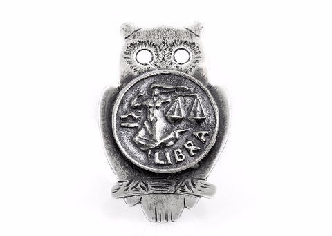 Coin ring with the Libra coin medallion on owl