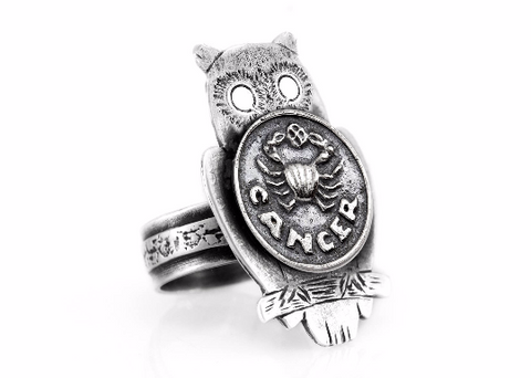 Coin ring with the Cancer coin medallion on owl
