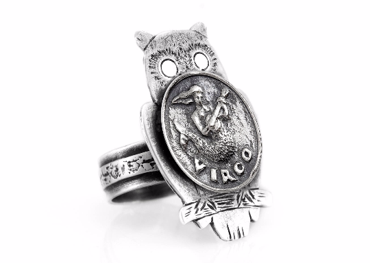 Coin ring with the Virgo coin medallion on owl