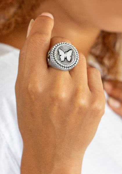 coin ring with the Butterfly medallion on fleur de lis ring