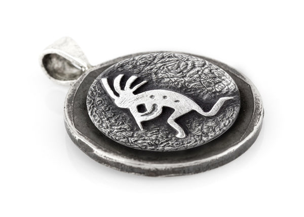 Kokopelli coin medallion and the Buffalo Nickel coin of USA