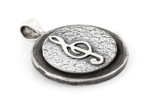 Treble Clef coin medallion and the Buffalo Nickel coin of USA