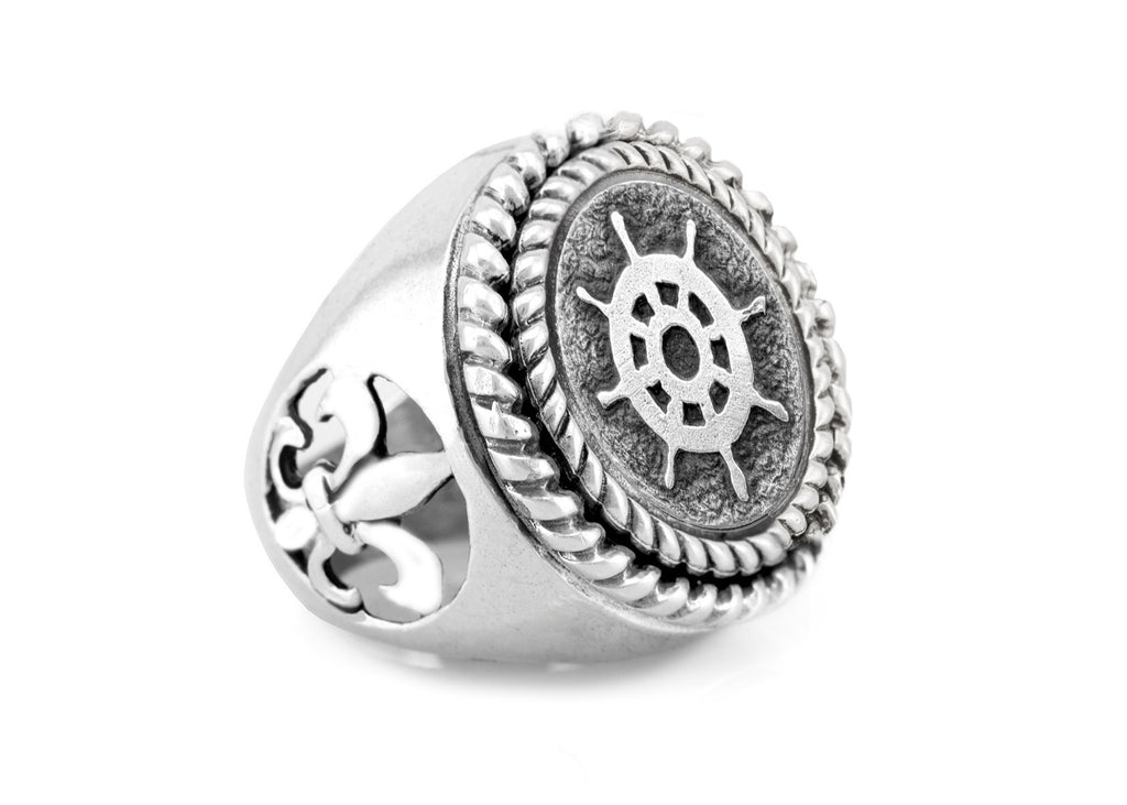 wheel coin medallion on fleur de lis ring