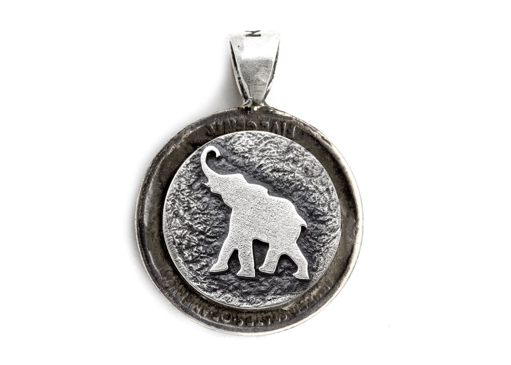 Elephant coin medallion and the Buffalo Nickel coin of USA
