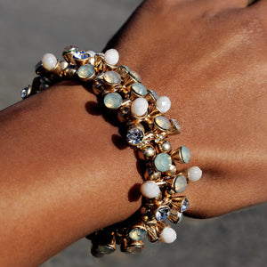High Polished Bracelet Featuring Elegant Faux Stones.