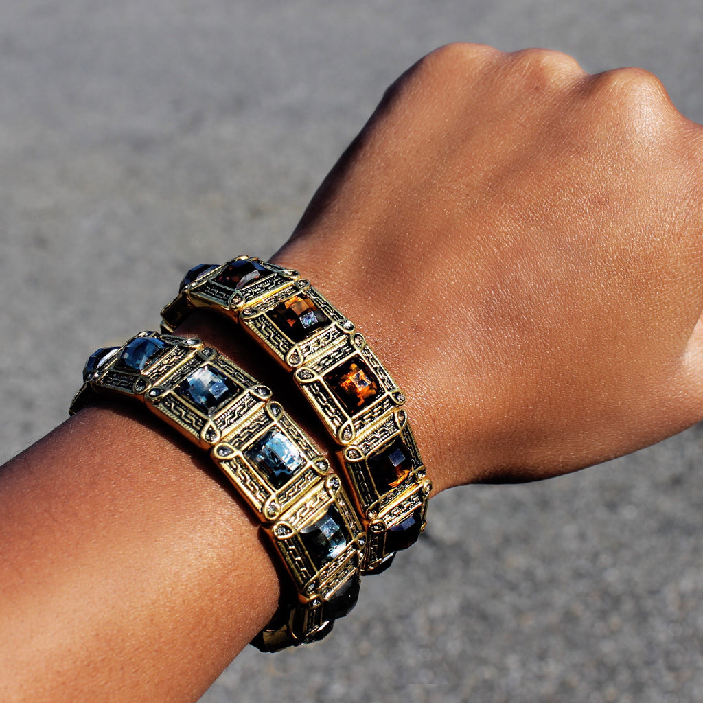 Antique Inspired Stretch Bracelets Featuring A Colored Gem.