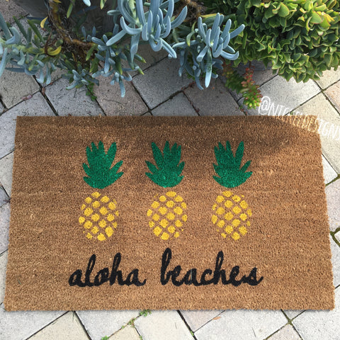 Aloha Beaches Pineapple doormat. Hand painted, customizable outdoor welcome mat brightly greets your guests. Great housewarming gift!