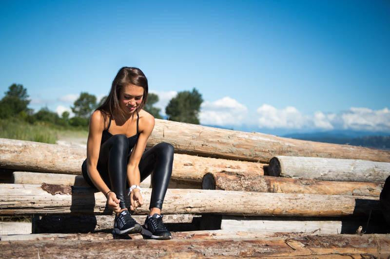 girl lace up her shoes and wearing Crystalline Legging