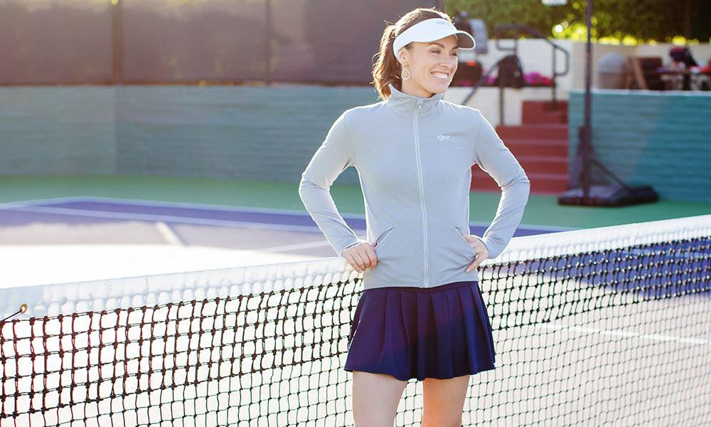 Martina Hingis wearing Altitude Jacket and Drop Short Skort