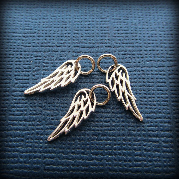 Three angel wing charms
