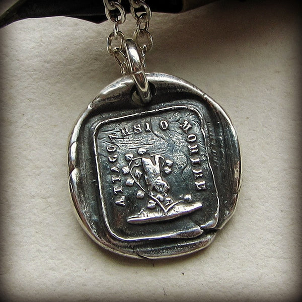 Attached until death wax seal pendant.