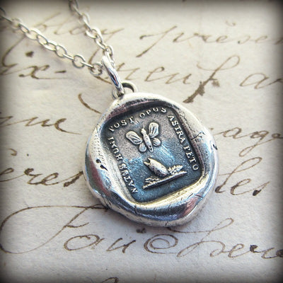Cocoon & butterfly wax seal necklace on old english script.