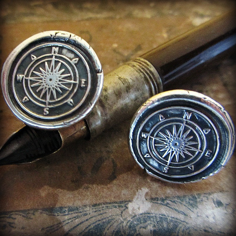 Compass Cuff Links on a marble background
