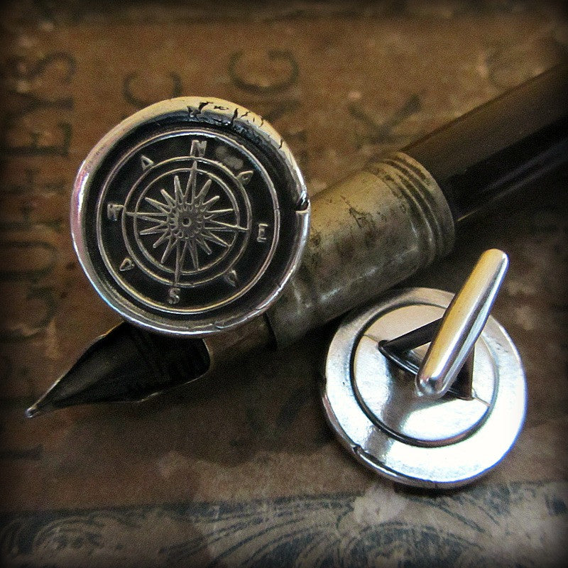 Compass Cuff Links on a fine tipped antique pen