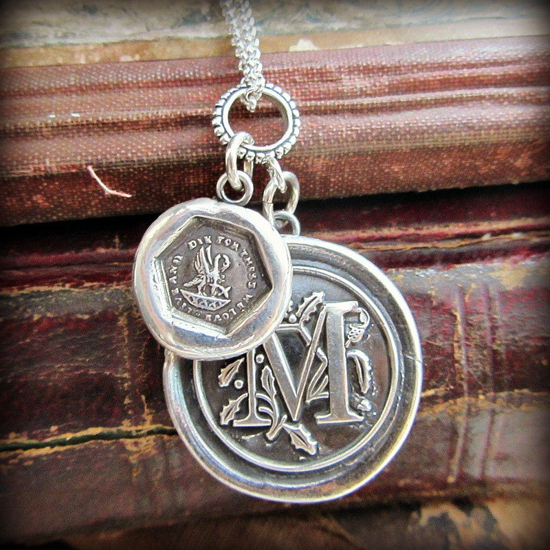 A mother's love personalized wax seal medallion over a stack of old books.