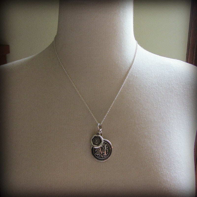 This personalized wax seal medallion is wrapped around a mannequin and expresses a mother's love.