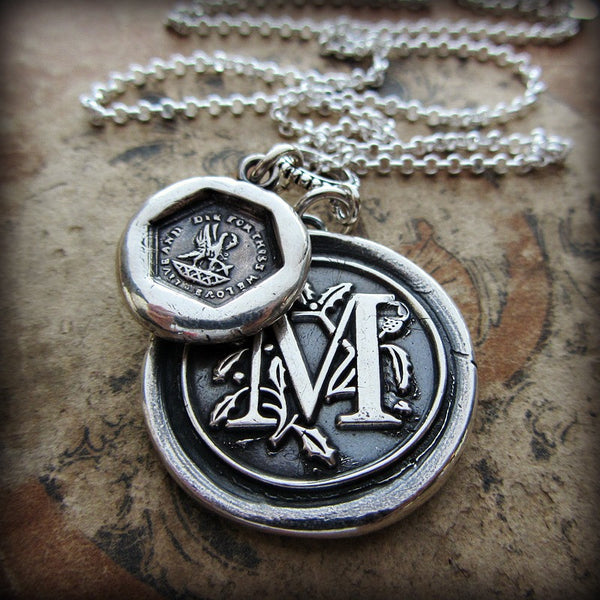 Our personalized Wax Seal Medallion with the letter M on it with old english in the background.