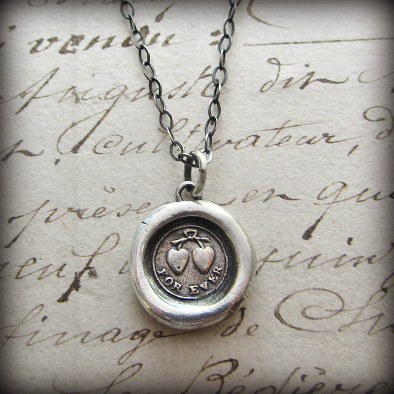 Forever Victorian Wax Seal Necklace over old english script