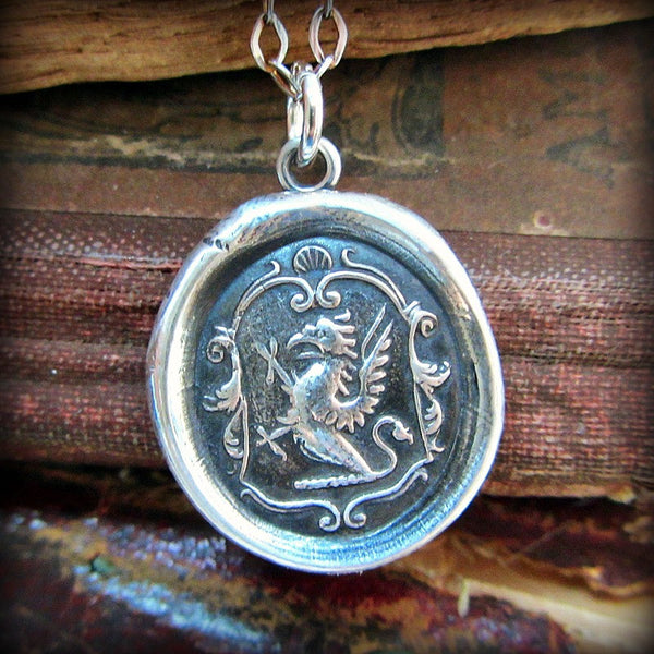 Griffin wax seal crest expressing courage, perseverance & watchfulness.