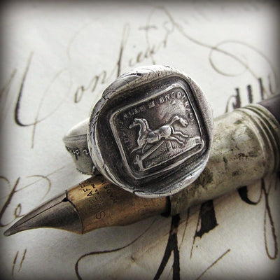 Horse Wax Seal Ring on a fine tipped antique pen.