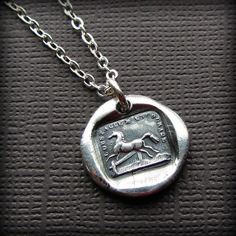 Horse Wax Seal Necklace with a silver chain.
