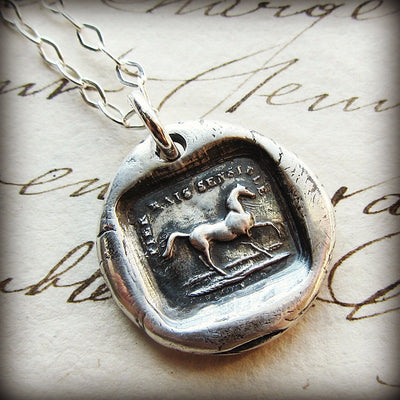 Horse wax seal with the phrase High Spirited But Sensible around it