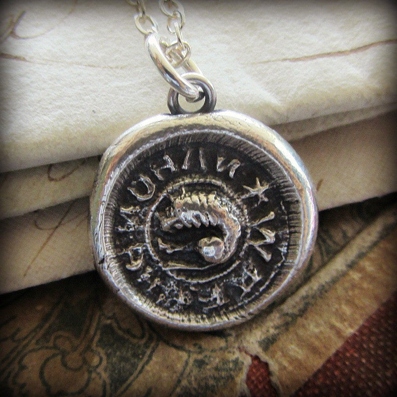 Medieval lion wax seal necklace.