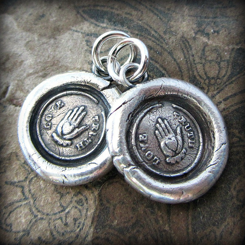 Two love truth victorian wax seal necklaces attached at the top