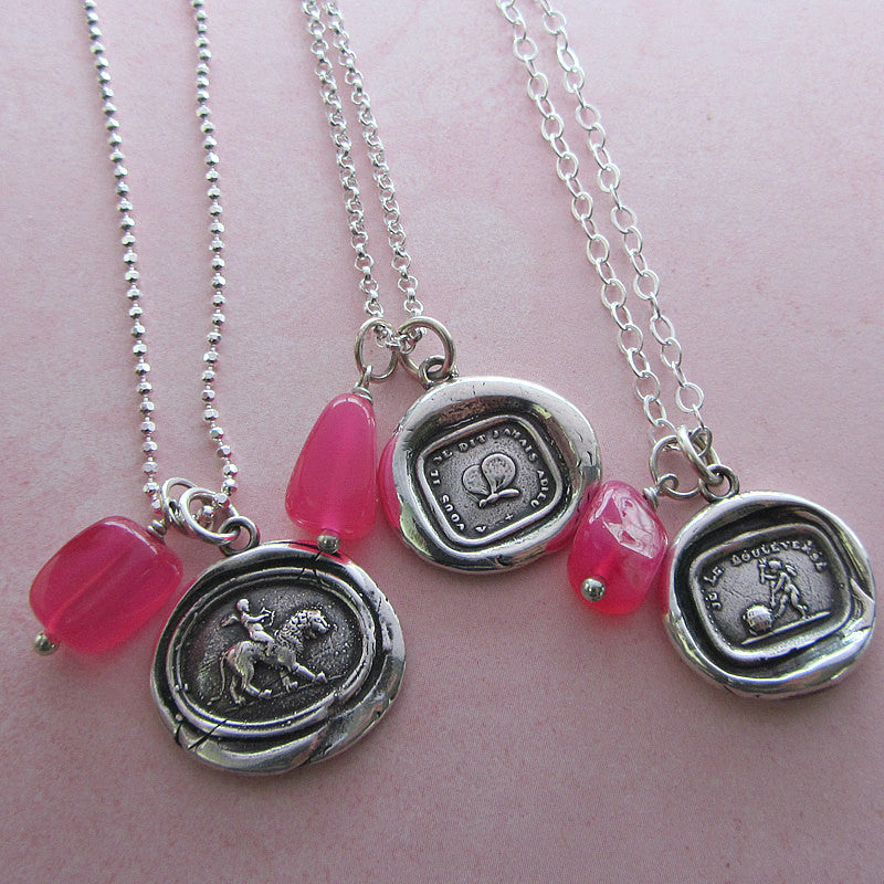 Hot pink chalcedony nugget charms attached to wax seal necklaces.