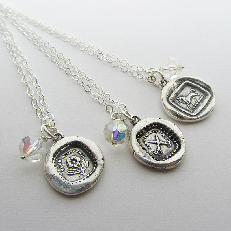 Three vintage reclaimed swarovski crystal attached to a wax seal necklace.