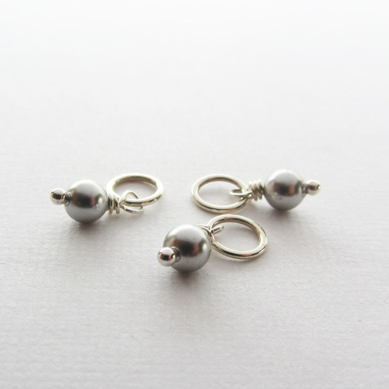 Three swarovski silver pearls.
