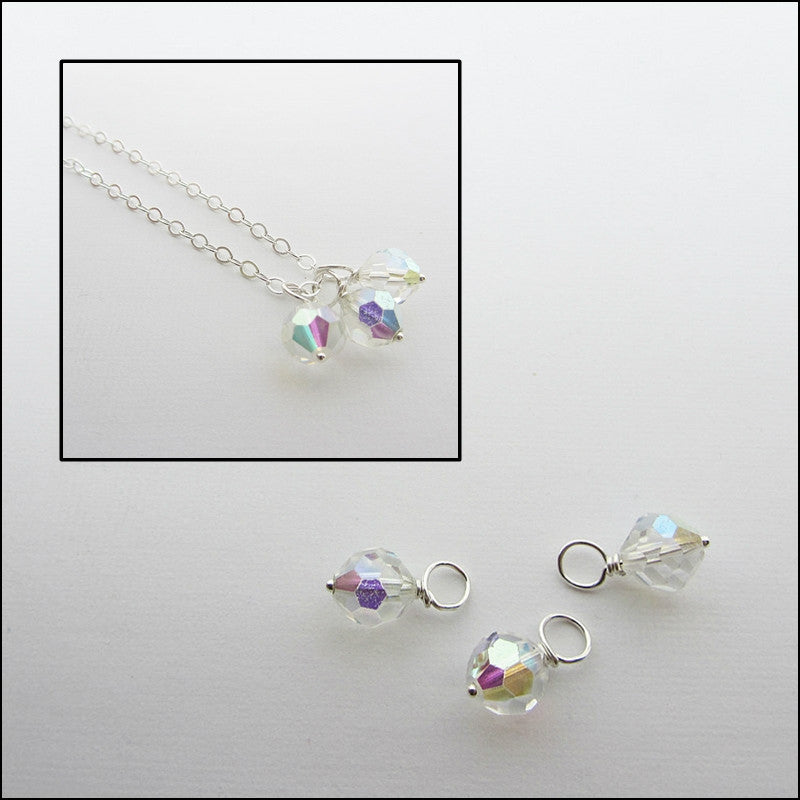 Three vintage reclaimed swarovski crystal with a close up of the three necklaces.